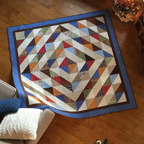 Luke's Half Square Triangle Around the World Quilt