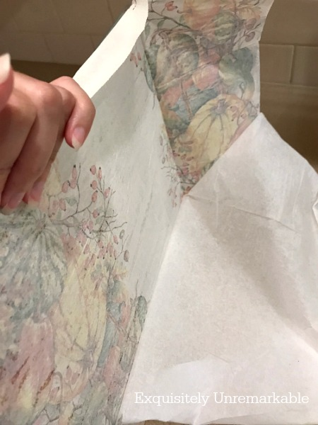 Cleaning up edges of decoupaged napkin on glass