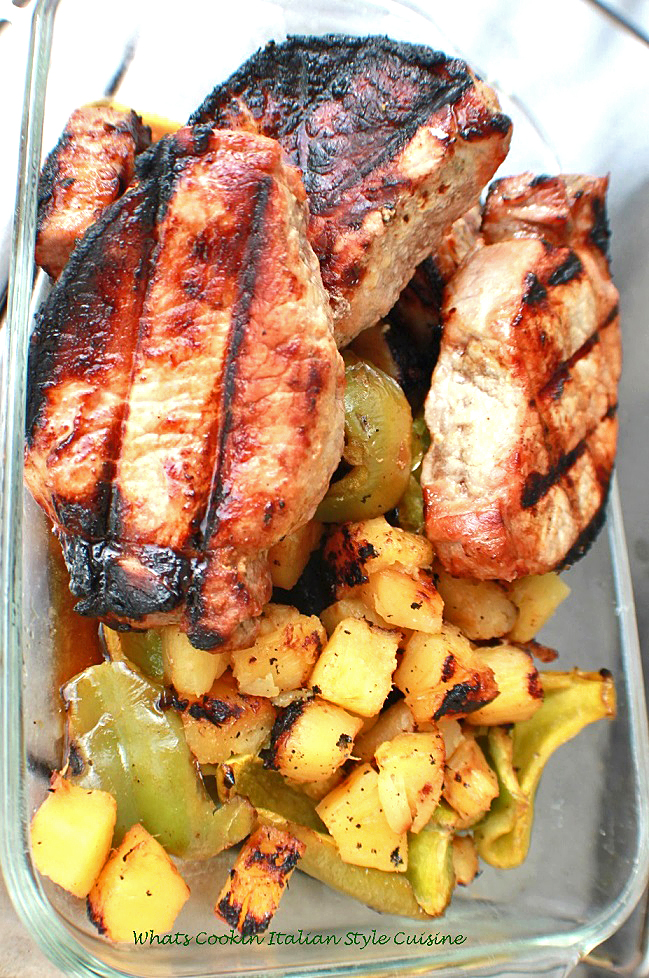 these are boneless pork chops that have been marinated and then cooked on indirect heat outside on a grill topped with pineapple and peppers with a delicious Polynesian sauce it was marinated in