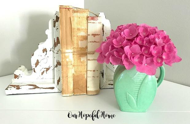 chippy corbel bookends deconstructed books green creamer pink hydrangeas