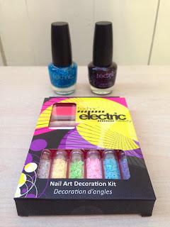 a blue nail varnish, a black nail varnish, and a nail art decoration kit