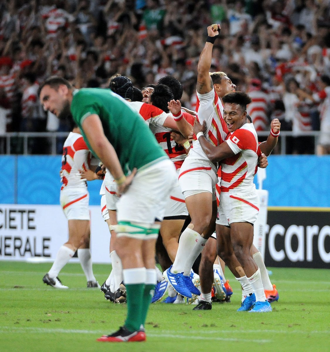 Japan celebrate scoring a try against Ireland in the 2019 Rugby World Cup