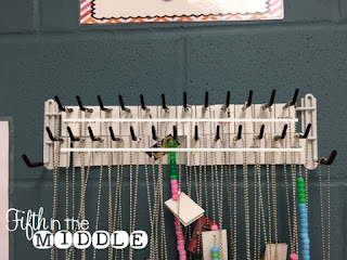 A Closetmaid belt and tie rack attached to the wall with Command strips makes a perfect storage solution.