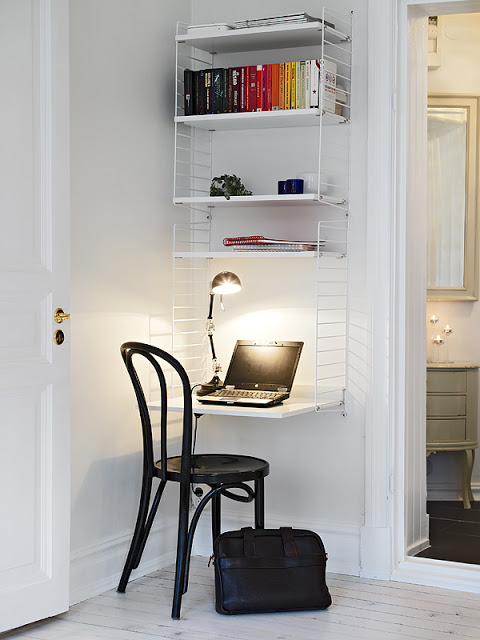 a small desk station fits perfectly in that corner