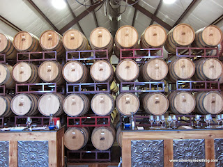 Look at all the wine barrels stacked
