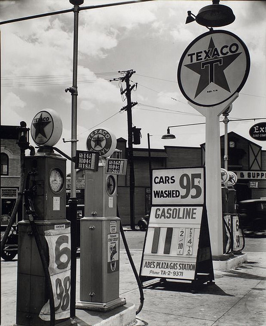 Gasoline station, Tremont Avenue and Dock Street, Bronx. July 02, 1936. Notes: Code: II.C.4. Exhibited: Modern Vision #86 Four gas pumps and tall Texaco sign at Abe's Plaza Gas station, with price for gas listed at 11 2/10 cents, cars washed for 95 cents. Source: Changing New York / Berenice Abbott. Repository: The New York Public Library. Photography Collection, Miriam and Ira D. Wallach Division of Art, Prints and Photographs.