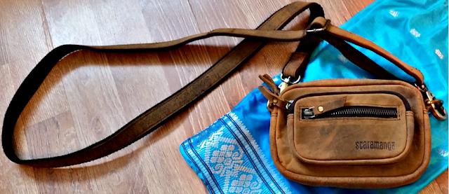 The Scaramanga leather micro handbag straps