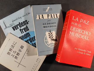 A set of four books in various languages.