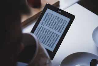 Image: Reading on an Kindle e-book reader. Photo by freestocks on Unsplash