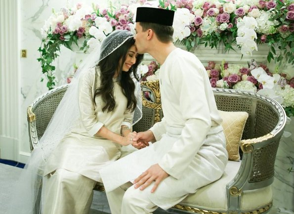 Dutchman Dennis Muhammad and Johor Princess Tunku Tun Aminah Maimunah Iskandariah Sultan Ibrahim, after wedding ceremony at the Istana Besar. wedding dress