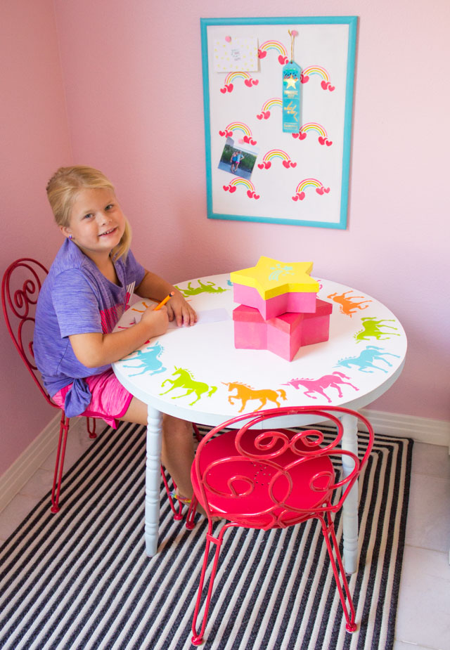 Create a kids workspace decorated with rainbow and unicorn stencils! #unicorndecor #rainbowdecor #kidstable #corkboard