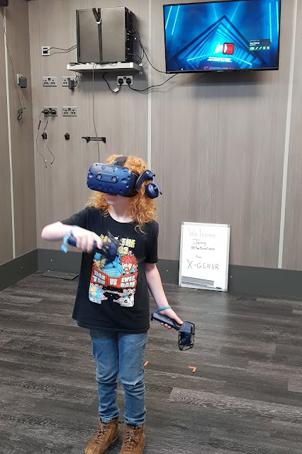 My youngest son playing Beat Saber VR game at X-Gen VR Stockport
