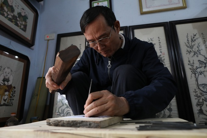 """Rat's Weddings"" galore as Vietnamese woodcut artist prepares for Tet"
