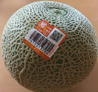 A whole Quincy melon with a QR code sticker