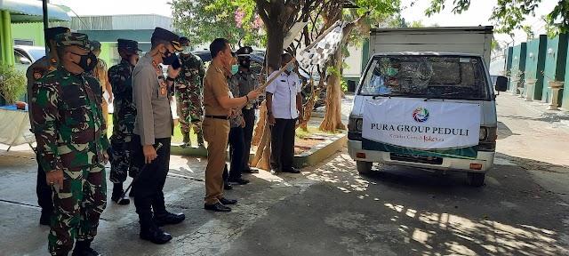 Bupati Kudus Serahkan Secara Simbolis Paket Sembako PT. Pura Pada Warga Terdampak Covid -19