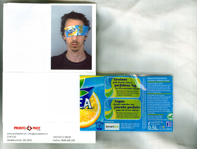 Scan of a photobooth photo taken in Switzerland with a guy having a NESTEA tag over his eyes.