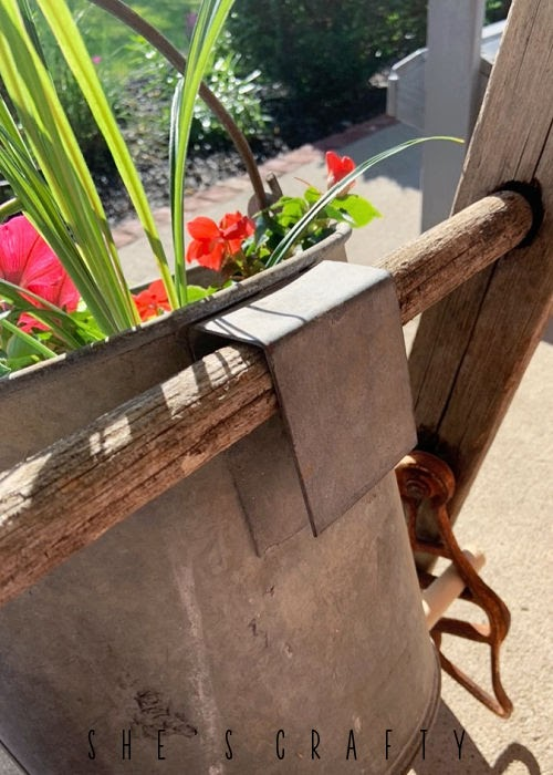 Bucket with hook to hang on a vintage ladder.
