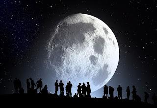 pessoas num cemiterio sob lua gigante