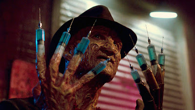 "Movie scene where Freddy Kruger has needles for fingers in ""Dream Warriors,"" the third Nightmare on Elm Street film"