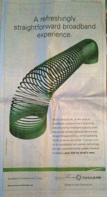 CenturyLink ad with green slinky on a white background, headline reads A refreshingly straightforward broadband experience