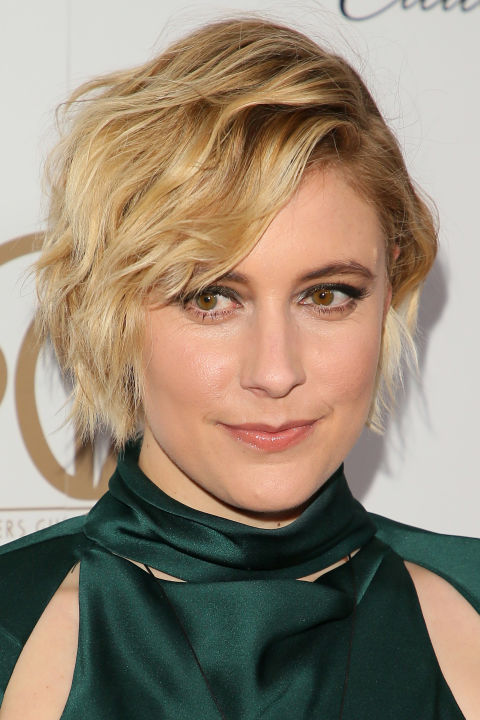 Greta Gerwig's highlights are strategically intensified toward the ends of her short hair so the darkness at her roots looks intentional, not clashy.