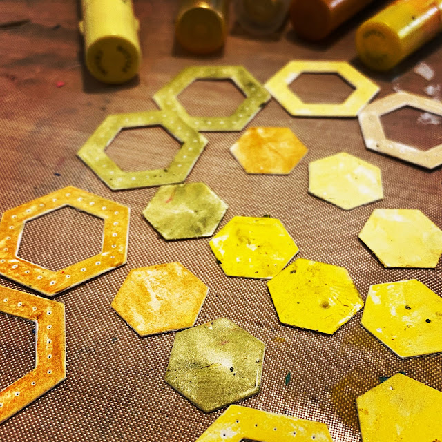 Die Cut hexagons colored with yellow faber castell gelatos for a card making
