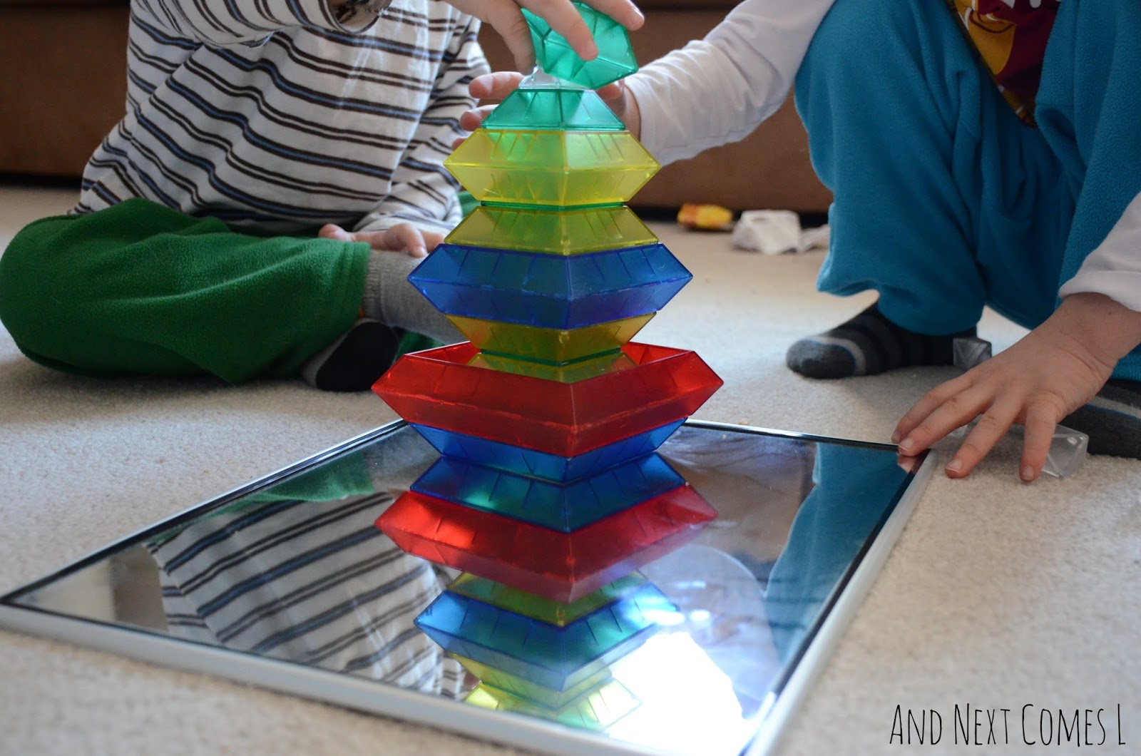 Siblings building together on a mirror with WEDGiTS from And Next Comes L