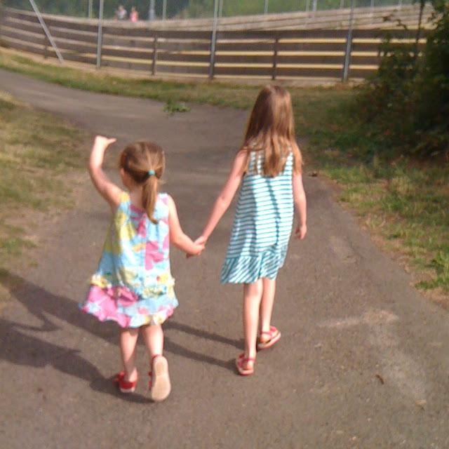 stephs two girls walking away hand in hand