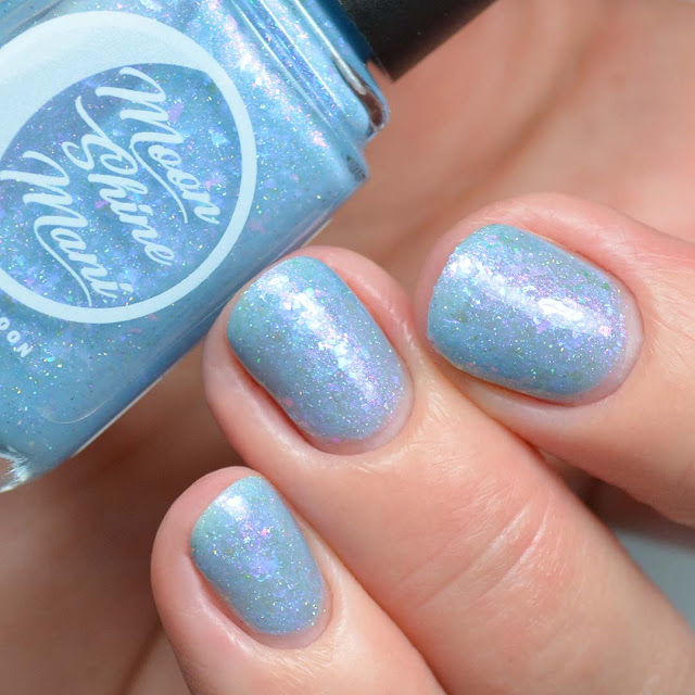 blue glitter nail polish with flakies swatch