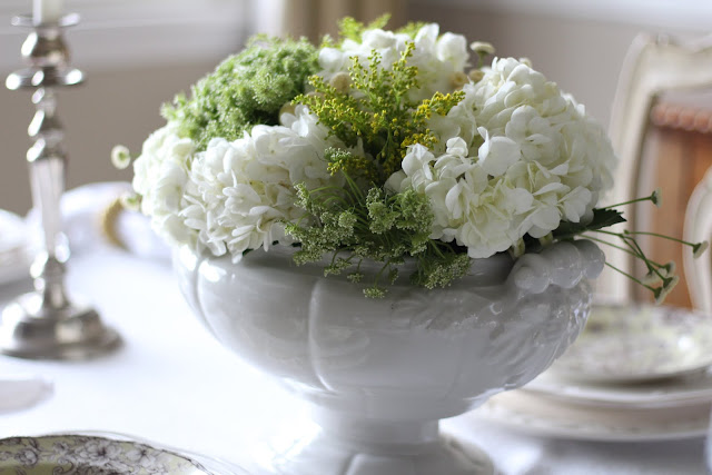 spring floral tablescape gorgeous centerpiece white ironstone white hydrangeas silver candlesticks