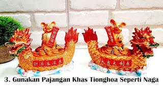 Gunakan Pajangan Dan Furnitur Khas Tionghoa Seperti Naga merupakan salah satu tips mudah buat dekorasi imlek di rumah
