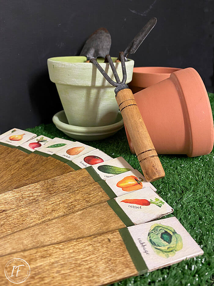 How to upcycle dollar store wooden plant label stakes into weatherproof rustic vegetable garden markers with vintage-style using DIY clear decals.