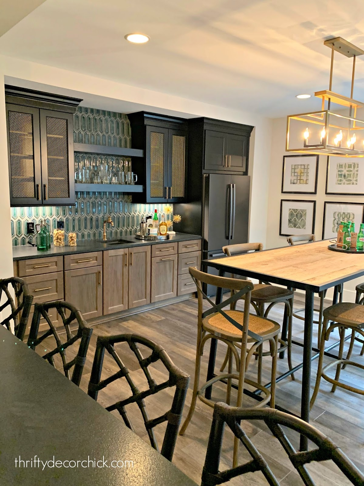 Basement bar with wood and blue cabinets