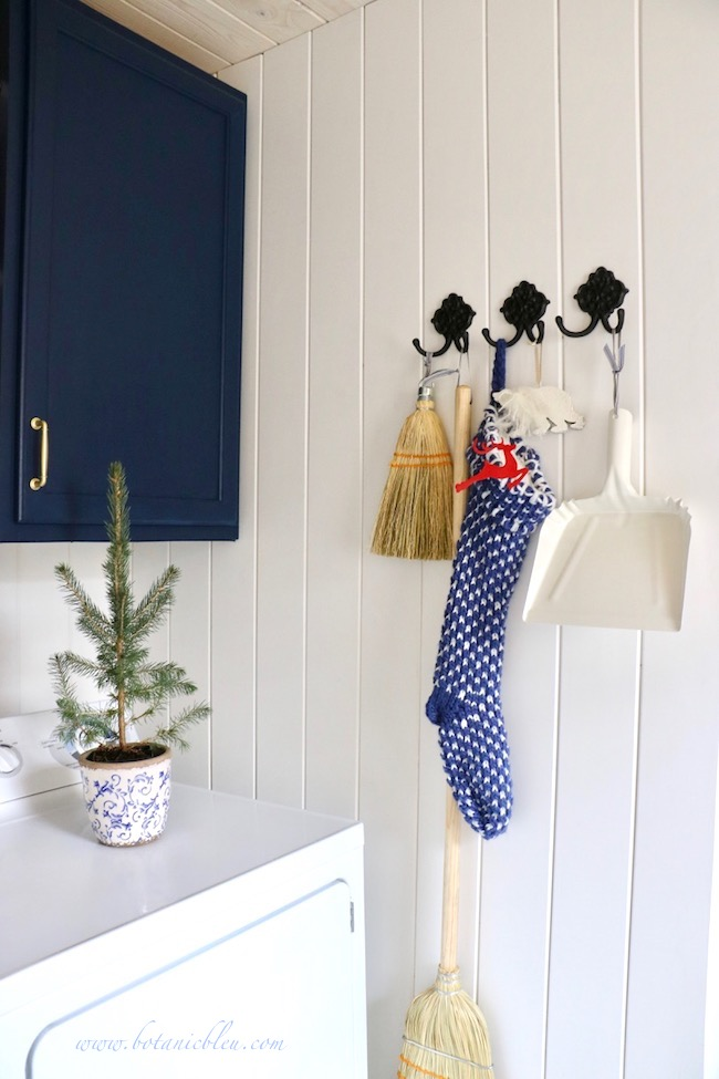 Blue Christmas Laundry Room open decorated early with blue and white knit stocking and Christmas ornaments