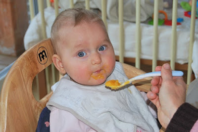When will a baby get good at eating form a spoon.