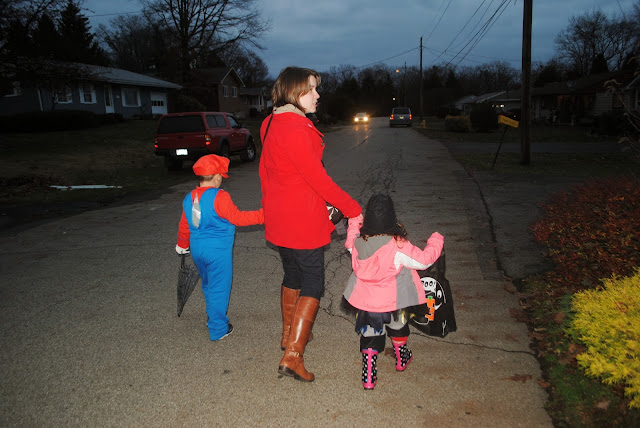 mario and tutu batman out trick or treat in the neighborhood