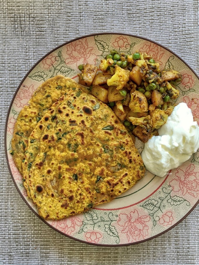 Methi Paratha served with yoghurt and aloo gobi matar