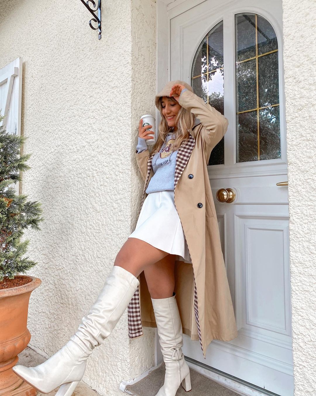 Trench coat and long white boots
