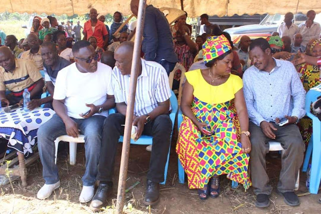 Lands CAS Gideon Mung'aro, Women Representative Gertrude Mbeyu sharing a podium in a funeral. PHOTO | BMS