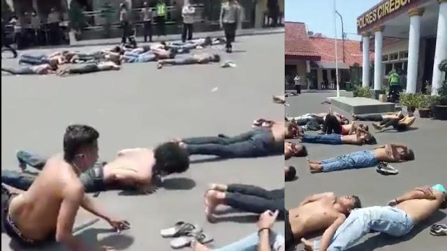 Viral Pendemo Dihukum Polisi Berjemur Telentang di Atas Aspal, Netizen: Mereka Bukan Kriminal!