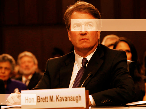 image of Brett Kavanaugh sitting to testify; I have highlighted his shifty eyes and the 'Hon.' before his name on the nameplate sitting in front of him