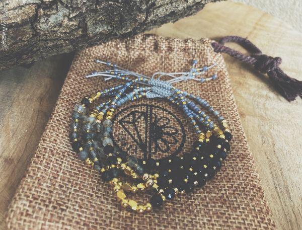 Bracelets fins en pierres naturelles d'onyx et de quartz rutile tourmaline My Roller Stone et son pochon en jute