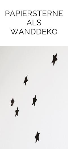 Schwarze Papiersterne an die Wand kleben als schlichte DIY Weihnachtsdeko   Tasteboykott
