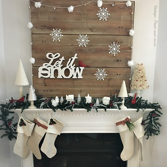 Vintage, Paint and more... let it snow mantel with diy cone trees, pom-pom garland, little painted houses and dollar store snowflake ornaments