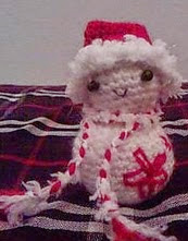 http://www.ravelry.com/patterns/library/candy-cane-snowman