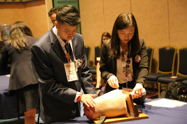 """High school students practice using a tourniquet during a 2019 conference in Orlando, Florida, after watching a web-based tutorial on how to """"Stop the Bleed."""" (USU photo by Sarah Marshall)"""