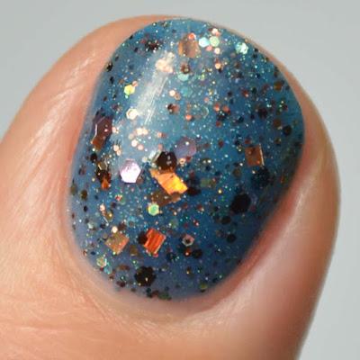 navy jelly nail polish with glitter swatch