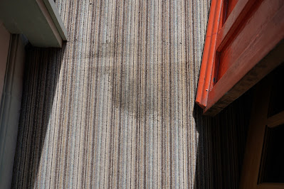 Carpet stain by front door of cottage