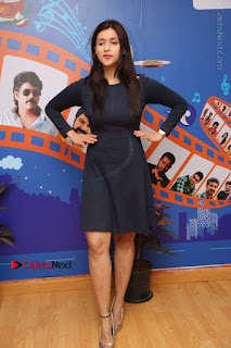Actress Mannara Chopra Stills in Blue Short Dress at Rogue Song Launch at Radio City 91.1 FM  0096.jpg