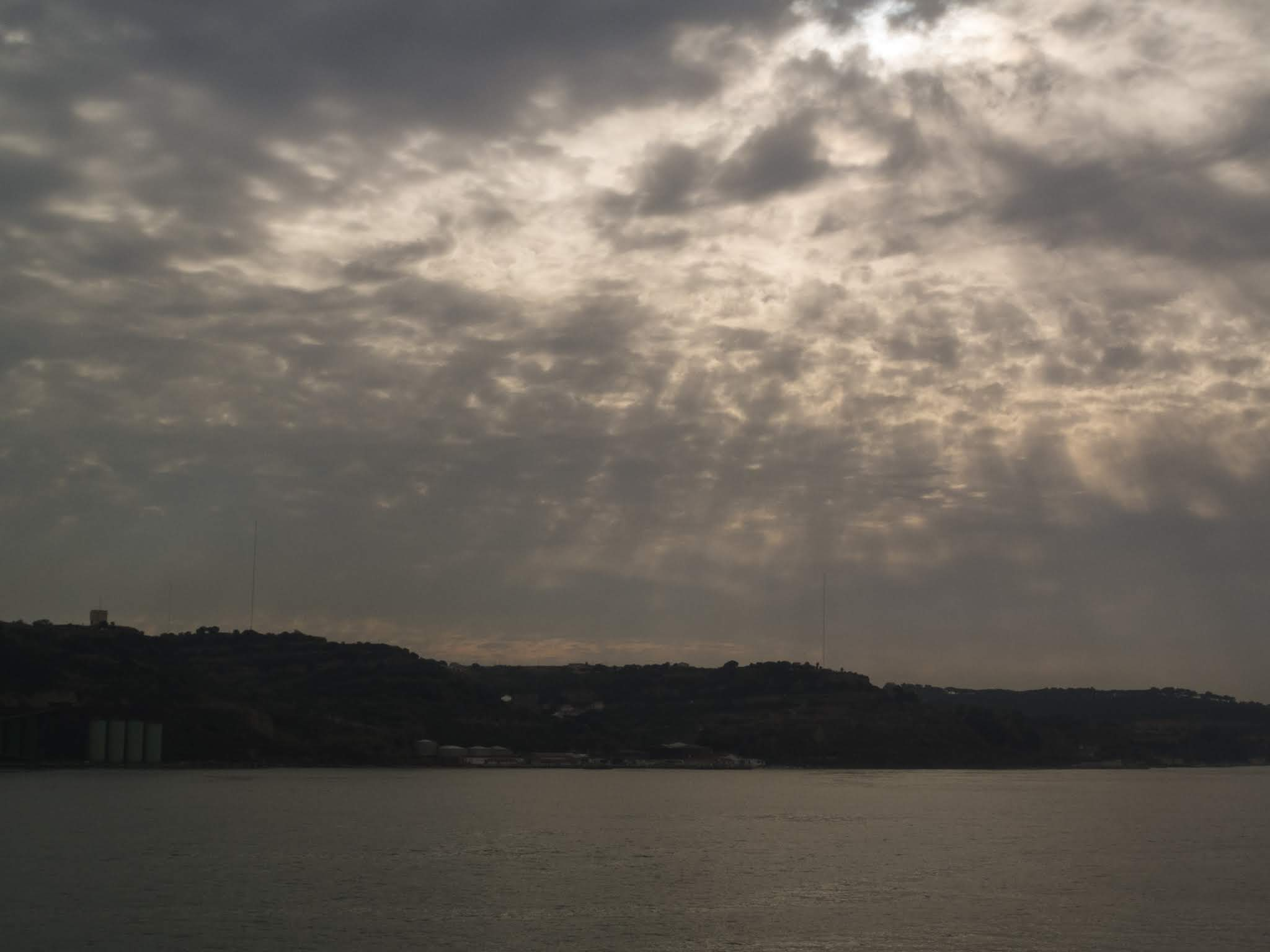 Sky and landscape on the Tagus river in Lisbon, Portugal.